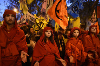 Climate activists march in silence during a 'Fridays For Future' protest in Madrid during the COP25 climate talks.