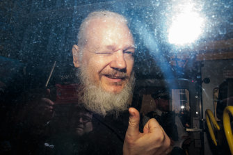 Julian Assange gestures to media from a police vehicle on his arrival at Westminster Magistrates court in April. The Ecuadorian Embassy in London had withdrawn his asylum after seven years.
