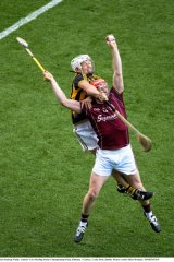 Joe Canning, front, gets some attention while going for a high ball.