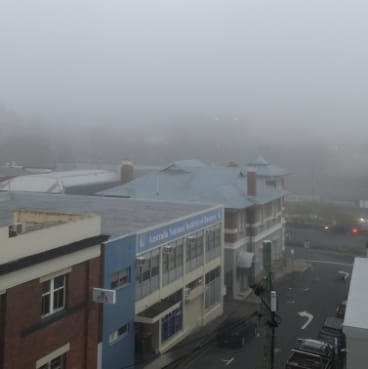 Fog covers inner-Brisbane just before 6am on Sunday.