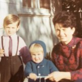 A two-year-old Adrian Piccoli (centre) with his best teacher, his mother Nives, and his brother Dino.