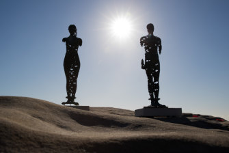 Egor Zigura's work, 'Kore that Awakening' and 'Colossus Awakening' at Sculpture by the Sea.