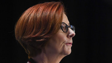 Julia Gillard has called for Australia's political parties to strike a UK-style bipartisan agreement over its aid budget.