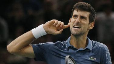 Louder: Novak Djokovic gestures to the crowd after his thrilling victory over Roger Federer.