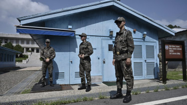South Korean soldiers stand guard at the truce village of Panmunjom in the Demilitarised Zone (DMZ) dividing the two Koreas on Saturday.