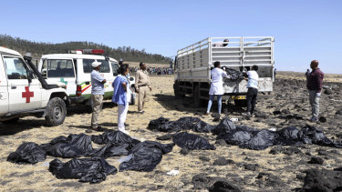 Rescuers remove body bags from the scene of an Ethiopian Airlines flight that crashed shortly after takeoff at Hejere near Bishoftu,  south of Addis Ababa, in Ethiopia.