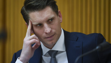 Committee chair Andrew Hastie reacts during a hearing of parliamentary intelligence and security committee at Parliament House in Canberra.
