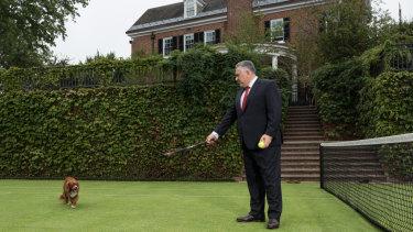 Joe Hockey on the tennis court at the ambassador's residence.