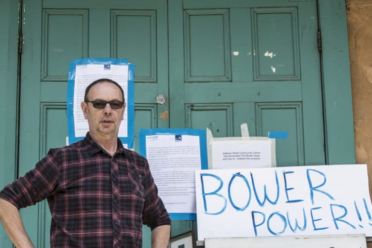 The Bower general manager Guido Verbist standing in front of eviction notices.