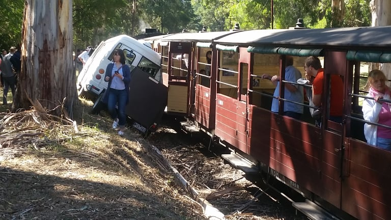 A tour bus and the Puffing Billy Steam Train collided.