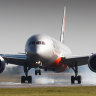 Five new Qld cases, passengers monitored after travellers infectious on flights