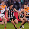 osh Kelly of the Giants runs with the ball from Scott Pendlebury of the Magpies during the Second Preliminary Final match between the Collingwood Magpies and the GWS Giants during in Week 3 of the AFL Finals Series at the MCG in Melbourne, Saturday, September 21, 2019.