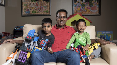 Niro Thambipillay and sons Sathyan, 5, and Shivan, 2, at their apartment in Pymble.