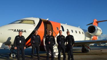 Left to right: Visual Observer Wayne Kinnaird, Captain Alexander James, Senior Base Observer Luke Vivarelli, Aircraft Mission Coordinator Chris Hinder, First Officer Kerry Staples.