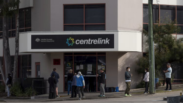 People queue outside Centrelink in Rockdale.