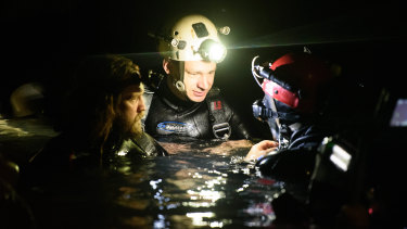 Cave divers Jim Warny, centre, and Erik Brown, left, play themselves in The Cave, the first film to document the extraordinary rescue of the Thai boys soccer team from Tham Luang cave in July 2018.