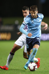 Milos Ninkovic competes with Joel Chianese of the Glory.