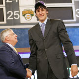 Stern congratulates Australian Andrew Bogut when he was taken as the No.1 NBA draft pick in the 2005 draft.