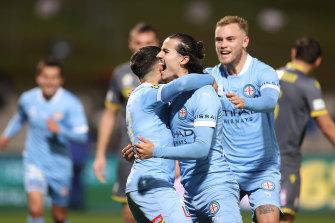 Stefan Colakovski celebrates with teammates after scoring in City's semi-final win over Macarthur.