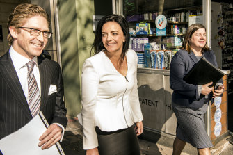 Emma Husar leaves the Supreme Court after her settlement with BuzzFeed with her lawyer Sandy Dawson SC and solicitor Amy Carr.