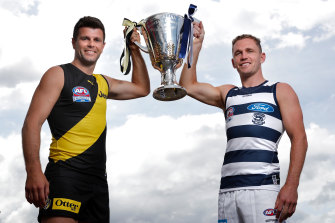Richmond captain Trent Cotchin (left) and Geelong counterpart Joel Selwood with the premiership cup.