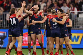Max Gawn celebrates with teammates after scoring in Melbourne's thumping win over Geelong.