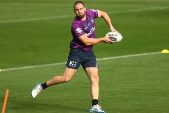 Offloading: Melbourne Storm's Chris Lewis on the ball during a training session at AAMI Park.