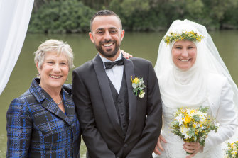 Heather and her husband Sami  on their wedding day in 2017, with Di.