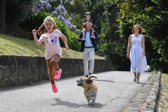 Treasurer Josh Frydenberg and his wife Amie, daughter Gemma, son Blake and their dog Fonzie.