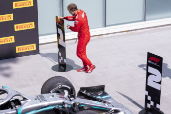 Ferrari driver Sebastian Vettel switches the standing markers post-race to vent his displeasure at the time penalty which cost him the victory.