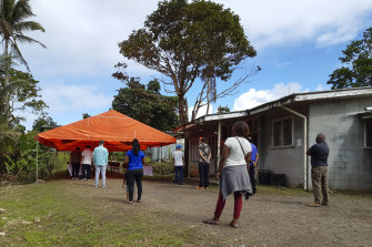 People queue for a COVID-19 vaccination in Suva, Fiji, last month.