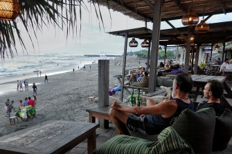Locals and foreigners soak up life by the beach in Bali last week.