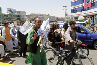 A man sells Taliban flags in Herat province, west of Kabul, Afghanistan, on Saturday, August 14.