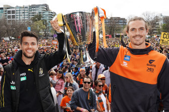 Captains Trent Cotchin and Phil Davis with the Premiership Cup.