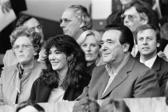 Ghislaine Maxwell and her father, the late media tycoon Robert Maxwell, watch a soccer match between Oxford United - which Robert Maxwell owned - and Brighton & Hove Albion in 1984.