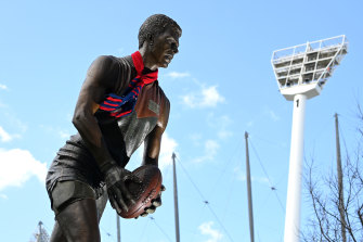 A Demons scarf adorns the statue of Jim Stynes outside the MCG