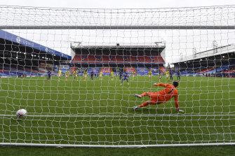Crystal Palace's Wilfried Zaha sends Brighton goalkeeper Mathew Ryan the wrong way on Sunday.