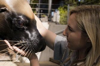 Marine Mammal Keeper Rie Van Gogh with Marlie, an Australia Sea Lion.