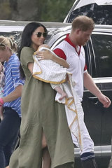 Meghan, Duchess of Sussex, with baby Archie, Prince Harry and her roomy yet chic linen sack dress.