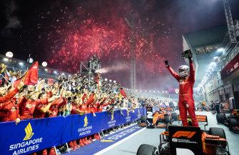 Sebastian Vettel celebrates winning the Singapore Grand Prix for Ferrari on Sunday.