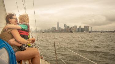 Miriam Hart and Argenta, 3, on the boat welcoming Greta Thunberg to New York.