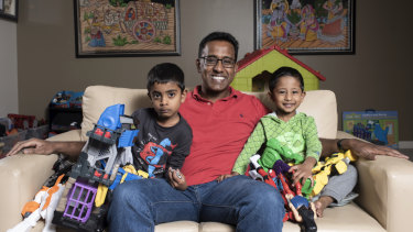 Niro Thambipillay and the sons of Sathyan, 5, and Shivan, 2, in his apartment in Pymble.