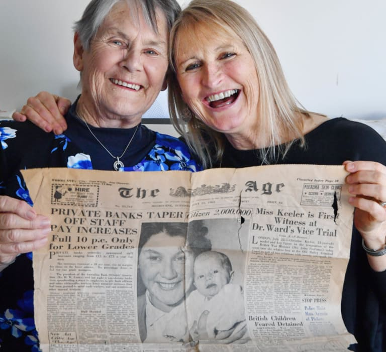 Look at us: Loretta Hill (right) and mother Judy Johnston hold The Age's front page article from July 23, 1963, when baby Loretta was named Melbourne's 2 millionth citizen.