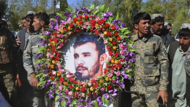 Military personnel held a photo of General Abdul Raziq, Kandahar police chief, who was killed by a guard, during his burial ceremony in Kandahar, Afghanistan, on Friday.