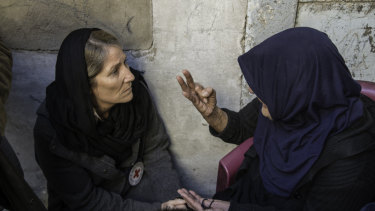 The head of the ICRC's Iraq delegation, Katharina Ritz, listens to an old woman who lost her whole family, her home and hope in an airstrike.
