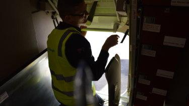 Senior Base Observer Luke Vivarelli opens the hatch where supplies can be dropped.
