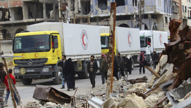 A convoy of Syrian Red Crescent trucks carrying humanitarian aid for civilians in Douma, eastern Ghouta, on Thursday.