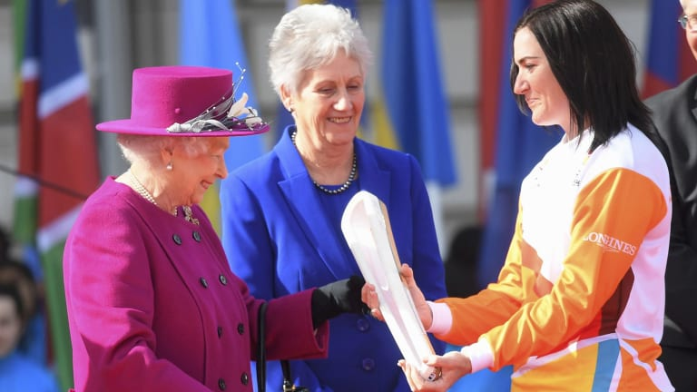 Retired cyclist Anna Meares receives the Queens Baton in London in March 2017 to begin the relay to Australia.