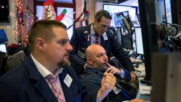 Global shares mixed as trade worries loom; oil surges on OPEC cuts