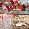100,000 people, 130 tonnes of prawns: 36 hours at the Sydney Fish Market